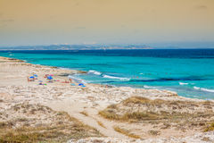 Tourists in Illetes beach Formentera island, Mediterranean sea, Stock Photos