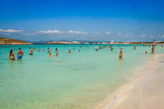 Tourists in Illetes beach Formentera island, Mediterranean sea, Stock Photography