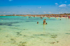 Tourists in Illetes beach Formentera island, Mediterranean sea, Royalty Free Stock Images