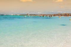 Tourists in Illetes beach Formentera island, Mediterranean sea, Royalty Free Stock Photo