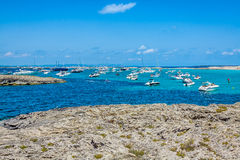 Tourists in Illetes beach Formentera island, Mediterranean sea, Royalty Free Stock Photo