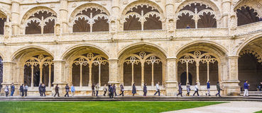 Tourists in the inner courtyard of the Jeronimos Monastery Cloister in Lisbon Royalty Free Stock Photos