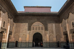 Tourists in inner courtyard of Medersa of Ben Youssef, Marrakech Royalty Free Stock Photography