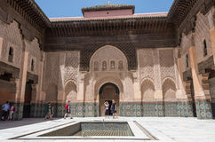 Tourists in inner courtyard of Medersa of Ben Youssef, Marrakech Stock Images