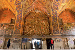 Tourists inside the historical rooms with old murals and decoration of palace Chehel Sotoun in Isfahan. Stock Photos