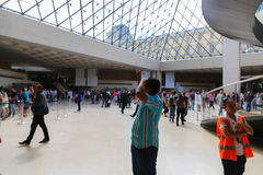 Tourists inside the Louvre - Paris Royalty Free Stock Photography