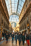 Tourists inside Vittorio Emanuele Gallery for shop Royalty Free Stock Photos