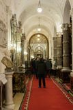 Tourists inspect the interior of the Peles castle in Sinaia, in Romania Royalty Free Stock Image