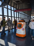Tourists interact with the robot on the Tokyo TV tower Royalty Free Stock Photos