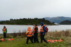 Tourists on the island of Navarino in Murray Channel in Tierra del Fuego. Royalty Free Stock Photography