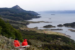 Tourists on the island of Navarino in Murray Channel in Tierra del Fuego. Stock Photography