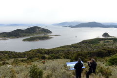 Tourists on the island of Navarino in Murray Channel in Tierra del Fuego. Royalty Free Stock Photo