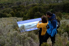 Tourists on the island of Navarino in Murray Channel in Tierra del Fuego. Royalty Free Stock Photos