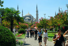 Tourists in Istanbul - Turkey. Tourists in Sultan Ahmed park, leaving from the Blue Mosque Stock Image