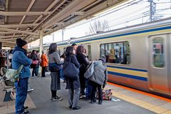 Tourists and japanese people are waiting for Yokosuka line train to Tokyo. royalty free stock photography