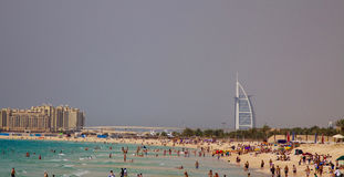 Tourists at the Jumeirah beach in Dubai, UAE.  Royalty Free Stock Photos