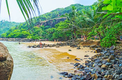 Tourists on Jungle Beach. UNAWATUNA, SRI LANKA, DECEMBER 4, 2016: The tourists enjoy the Jungle Beach, located in greenery of Rumassala Mount`s slope, on royalty free stock photo