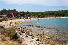 Tourists on Kamenjak peninsula beach by the Adriatic Sea in Premantura, Croatia royalty free stock photography
