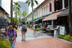 Tourists in the Kampong Glam, Singapore. SINGAPORE - CIRCA FEBRUARY, 2015: Tourists in the streets of the Arab quarter (Kampong Glam). Arab Quarter is the oldest Royalty Free Stock Photo