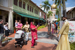Tourists in the Kampong Glam, Singapore. SINGAPORE - CIRCA FEBRUARY, 2015: Tourists in the streets of the Arab quarter (Kampong Glam). Arab Quarter is the oldest Royalty Free Stock Image