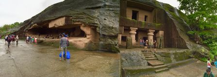 Tourists at Kanheri Caves in Mumbai - Panorama. The Kanheri Caves constitute a group of rock-cut monuments that are located to the north of Borivali on the Stock Photo