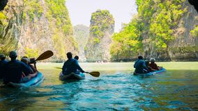 Tourists kayaking among limestone islands. Kayaking is a popular amusement for tourists stock video footage