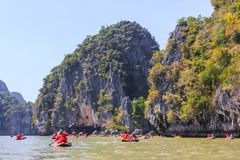 Tourists on kayaking trip. In Andaman sea, Thailand Royalty Free Stock Image