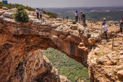 Tourists at the Keshet (Arch) Cave. People touring the site of the natural phenomenon of the Keshet (Arch) Cave, Upper Galilee, Israel, on May 12, 2016 Stock Images