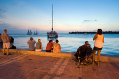 Tourists in Key West. KEY WEST, FLORIDA, USA - MAY 03, 2016: Tourists are relaxing at the waterside in the twilight on Mallory Square in Key West in Florida Stock Photography