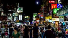 Tourists on Khaosan. Bangkok, Thailand - November 1, 2013 - Tourists and locals walk down busy Khaosan Road at night in Bangkok in November 2013. Bangkok is one Royalty Free Stock Images