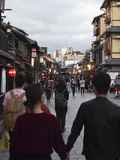 Tourists in Kyoto. A couple walks hand-in-hand down the streets of old Kyoto Royalty Free Stock Photography