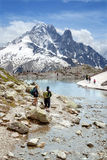 Tourists at Lac Blanc in Mont Blanc massif. CHAMONIX, FRANCE - JULY 01, 2014: Tourists at Lac Blanc in Mont Blanc massif near from Chamonix, France Stock Images
