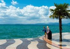 Tourists at a lake Stock Photo