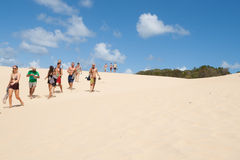 Tourists at Lake Wabby sand blow, Fraser Island, Queensland, Australia. stock image
