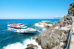 Tourists landing on the coast of Riomaggiore, Cinque Terre Royalty Free Stock Image