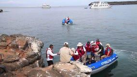 Tourists landing on North Seymour Island, Galapagos National Park, Ecuador stock footage