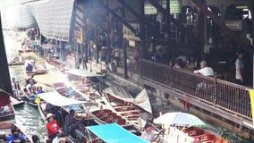 Tourists landmark scene at Damnoen Saduak Floating  in the morning stock footage