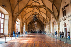 Tourists in largest room of Prague Castle. PRAGUE - OCTOBER 02: Tourists in largest room of Prague Castle on October 02, 2013 in Prague. The Guinness Book of Royalty Free Stock Photos