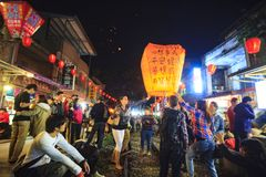 Tourists Launching Sky Lantern Along Railway Next to Shifen Trai Royalty Free Stock Images