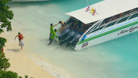 Tourists leave speedboat stock video