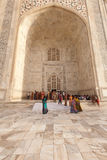Tourists leave tomb portico at the Taj Mahal Stock Photography