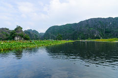 Tourists, limestone cliffs, Ngo Dong river in Tam Coc Grotto Royalty Free Stock Images