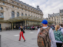 Tourists in line to the museum. Tourists standing in the long line wating to enter the d`Orsay Museum in Paris, France Royalty Free Stock Images