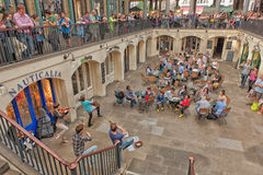 Tourists listen to a singer in Covent Garden Stock Photography