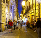 Tourists listen to street musicians. Granada Stock Image