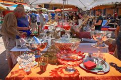 Tourists and local people buy old goods at famous antique market. NICE, FRANCE - MAY 13, 2013: Tourists and local people buy old goods at famous antique market royalty free stock photography