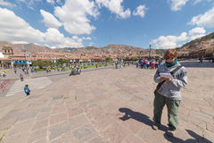 Tourists and local people on main square in Cusco, Peru Royalty Free Stock Image