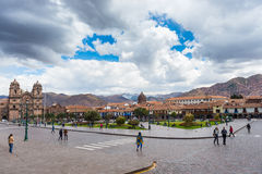 Tourists and local people on main square, Plaza de Armas, in Cusco, Peru, former Inca capital, fa Stock Image