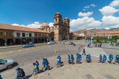 Tourists and local people on main square, Plaza de Armas, in Cusco, Peru, former Inca capital, fa. Cusco, Peru - September 3, 2015: Tourists and local people on stock images