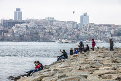 Tourists and local People relaxing near Bosphorus strait Stock Photo